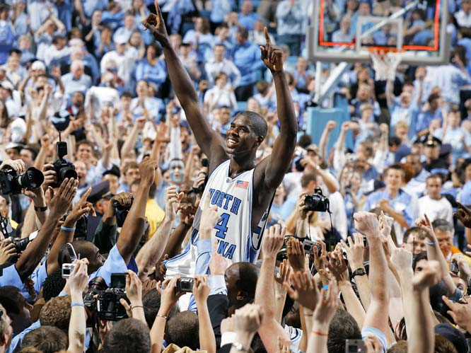 North Carolina's Marvin Williams is lifted by fans after the Tar Heels defeated Duke, 75-73, in the regular season finale.