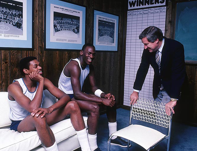 Coach Dean Smith enjoys a laugh with his star players,  Michael Jordan and Sam Perkins.
