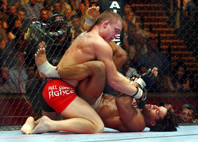 In their UFC 34 welterweight title bout, Matt Hughes (top) and Carlos Newton fought until 1:27 into the second round. However, some argued that the fight should have ended earlier. After getting caught in a triangle choke, Hughes yelled to his corner that he was out (he later admitted to doing so), but he managed to lift Newton up, slam him to the mat and render him unconscious. Hughes was granted a KO victory and the title.