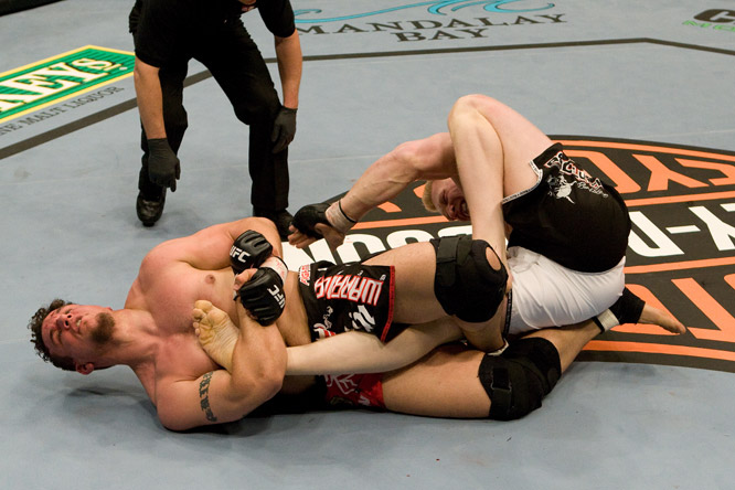 In his UFC -- and professional MMA -- debut, former WWE star Brock Lesnar (white trunks) came out swinging, giving former heavyweight champ Frank Mir an early beating. But after landing a slew of punches, Lesnar was docked a point for throwing several illegal shots to the back of the head. When the action restarted, Lesna took it to Mir again. But the veteran  toughed it out and managed to use his superior jiu-jitsu skills to win by submission. Today, some blame referee Steve Mazzagatti for taking points from Lesnar, while others blame Lesnar for his lack of MMA experience.