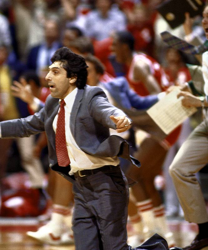 """Jimmy V's Wolfpack earned the nickname """"The Cardiac Pack"""" for their thrilling victories in March 1983.  N.C. State entered the tournament by beating Michael Jordan-led North Carolina and Ralph Sampson-led Virginia to capture the ACC championship. As the No. 6 seed, it continued to advance in dramatic fashion en route to a championship game against Houston's Phi Slamma Jamma -- one of the most famous David vs. Goliath matchups in sports history.  The Pack won the title on Lorenzo Charles' famous buzzer-beating dunk."""