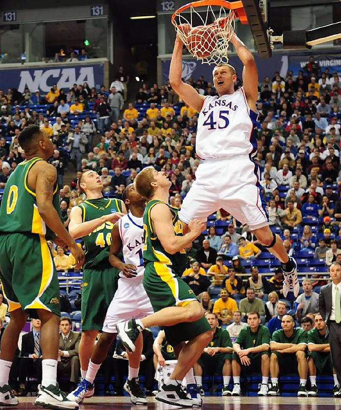 Cole Aldrich had 23 points and 13 rebounds as the defending national champions won their first game.