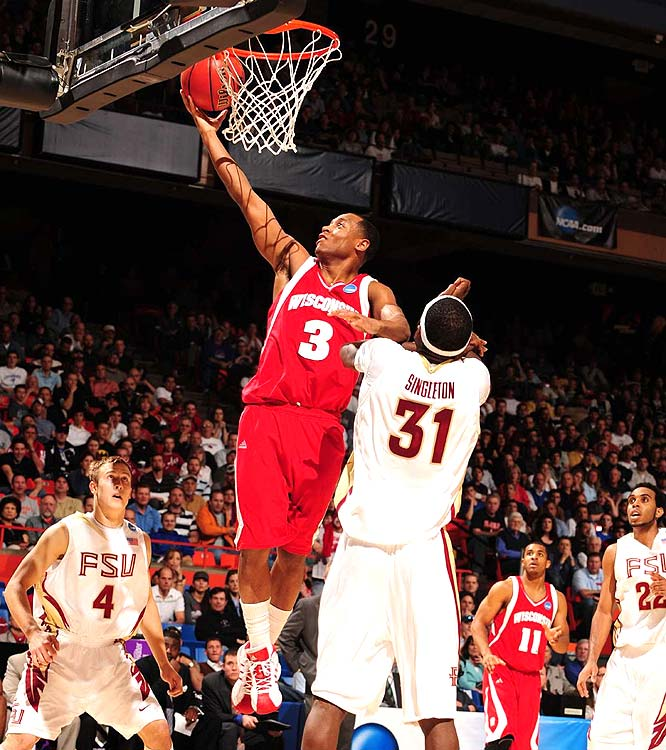 Wisconsin's Trevon Hughes scored 10 points, including a decisive bank shot with :02 left in overtime, as the Badgers knocked off the fifth-seeded Seminoles.