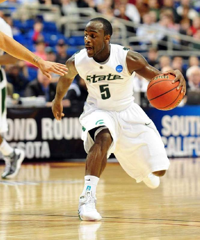 Travis Walton scored a career-high 18 points to lift the second-seeded Spartans to a win over USC.