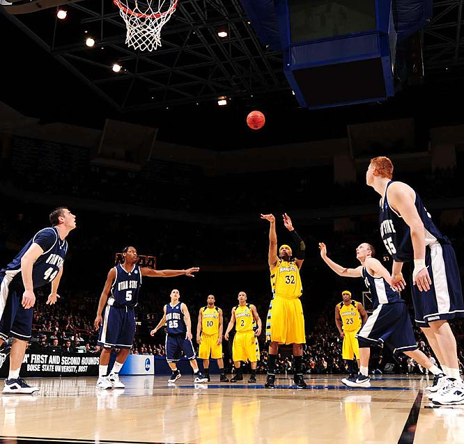 After Marquette  rallied from 14 down, Lazar Hayward sealed the victory with a rebound and free throw.