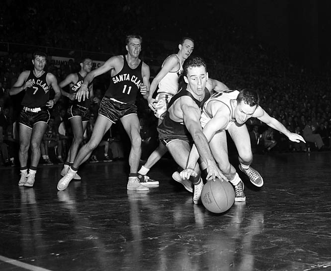 Former SI photographer Rich Clarkson has been to 53 NCAA Tournaments, beginning in 1952. Here are some of his favorite shots through the years.<br><br> The first time North Carolina coach Dean Smith appeared in the NCAA Final Four, he was a member of the 1952 Kansas team that won the national title. Here, Smith (white jersey) chases a loose ball in the semifinal with Santa Clara. Kansas went on to win 74-55.<br><br>Send comments to siwriters@simail.com.