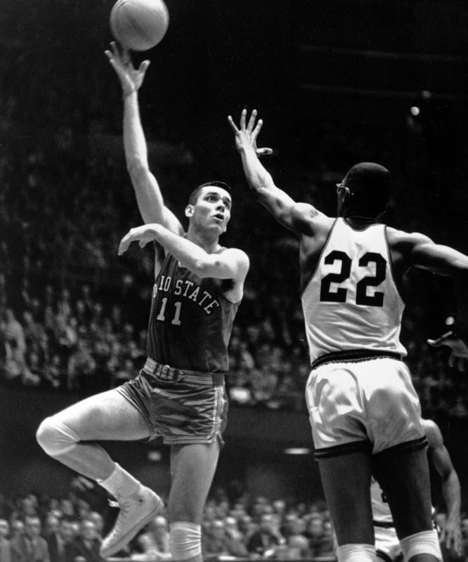 Ohio State's Jerry Lucas (11) and Cincinnati center Paul Hogue during the Buckeyes' 70-65 overtime loss in the 1961 title game.
