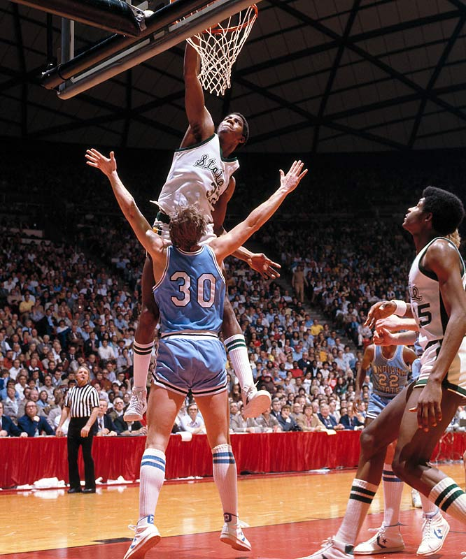 "Michigan State guard Earvin ""Magic"" Johnson dunks over Indiana State's Bob Heaton during the national title game in Salt Lake City.  Johnson was named Most Outstanding Player after Michigan State defeated Indiana State 75-64."