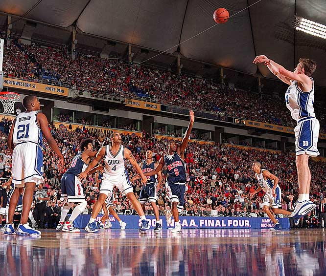 Duke forward Mike Dunleavy makes his third straight three-pointer in the second half against Arizona during the national championship game in Minneapolis. Duke won 82-72.