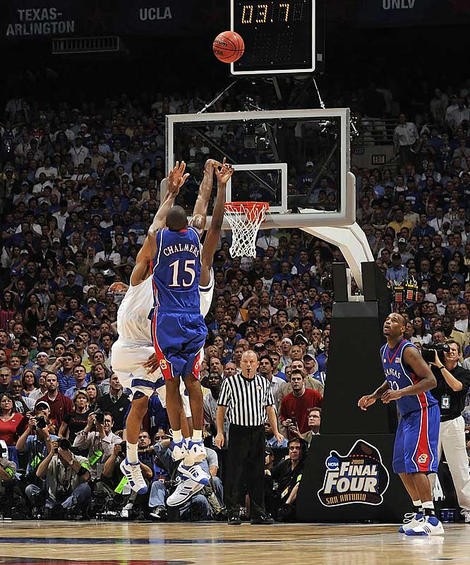 Mario Chalmers sinks a three-pointer to send the title game against Memphis into overtime. The Jayhawks went onto defeat the Tigers 75-68.