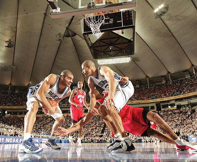 Duke's Carlos Boozer grabs a loose ball in front of teammate Shane Battier in a 2001 Final Four game against Maryland.
