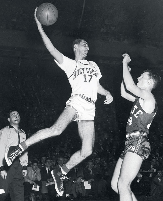Holy Cross legend Bob Cousy attempts a leaping pass in a 1950 tournament game against North Carolina State.