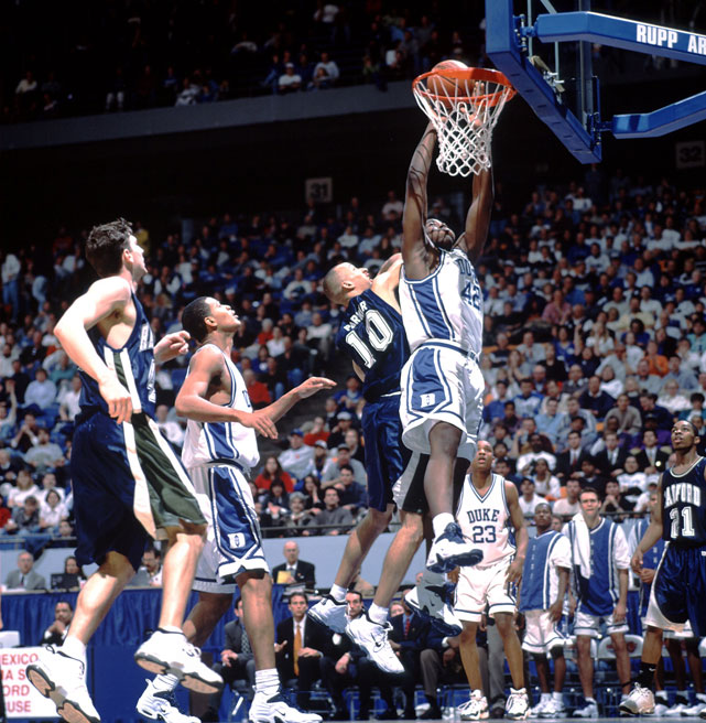 Duke's Elton Brand snags a rebound in 1998 early-round action against Radford.