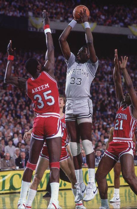 Georgetown's Patrick Ewing attempts a jumper over Houston's Hakeem Olajuwon -- then known as Akeem Olajuwon -- in the 1984 Championship game.