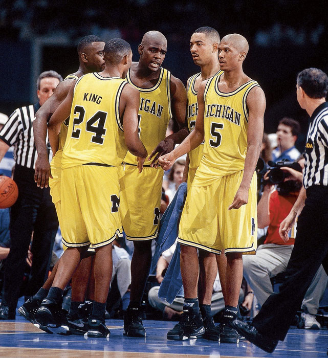 "Michigan's famed ""Fab Five"" -- (L-R) Jimmy King, Ray Jackson, Chris Webber, Juwan Howard and Jalen Rose -- huddle during the 1993 Championship game against North Carolina."