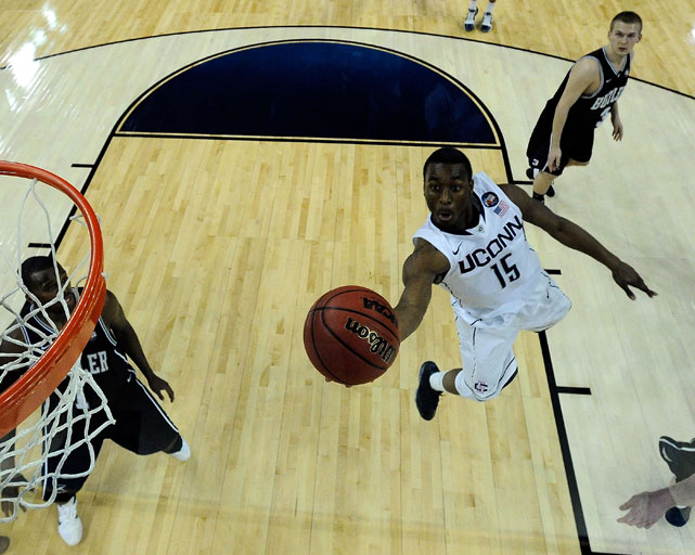 UConn point guard Kemba Walker goes to the basket in the 2011 Championship game against Butler. Walker led UConn over Butler to claim the tournament title for the Huskies.