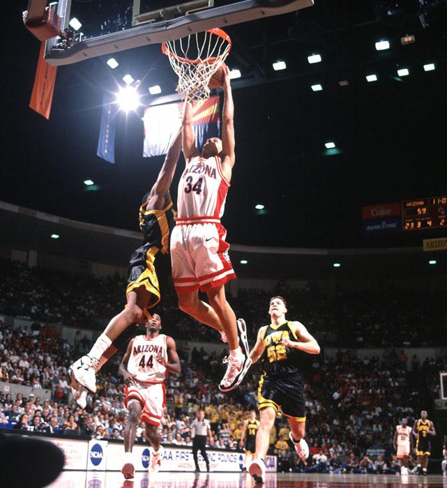 Arizona guard Miles Simon dunks on an Iowa player during the 1996 tournament.