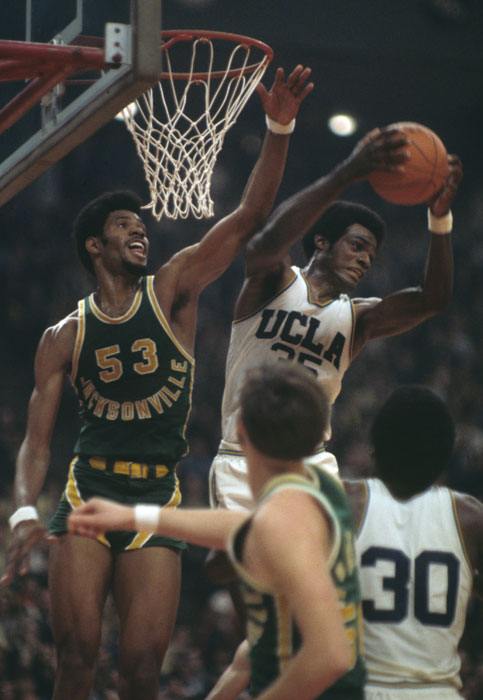 UCLA forward Sidney Wicks rips a rebound away from Jacksonville State's Artis Gilmore in the 1970 final.
