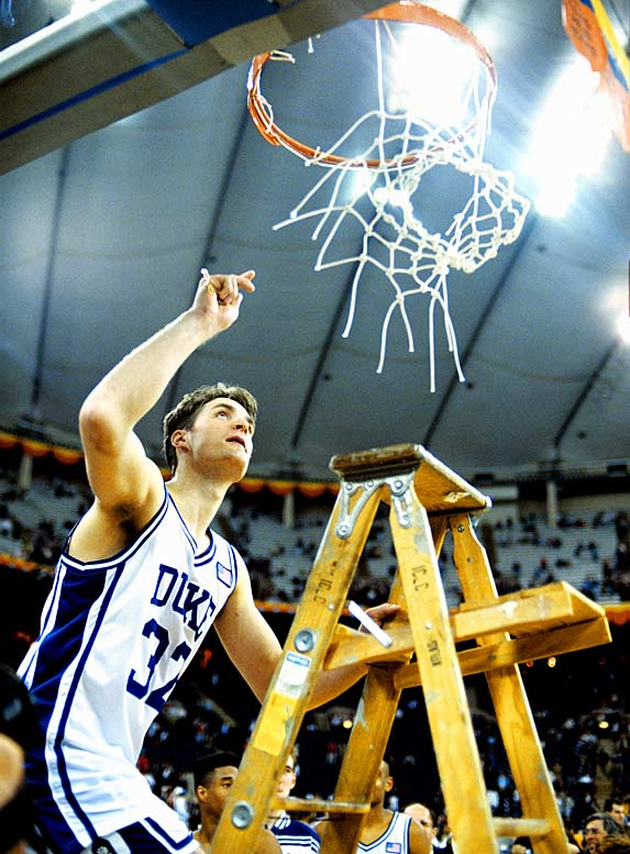 Christian Laettner cuts down the net after the Blue Devils beat Kansas for the national championship.