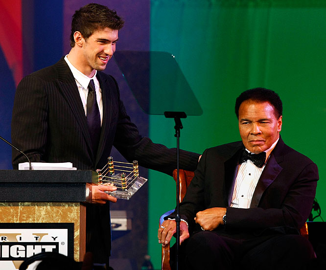 "Ali may be known as ""The Greatest,"" but he told Phelps that the swimmer deserved the nickname after his performance at the Olympics. The 14-time Olympic gold medalist was given the Sports Achievement Award during Ali's Celebrity Fight Night XV last week. During the event, Ali's wife told Phelps that the former champ was glued to the TV during the Olympics just to watch him win."