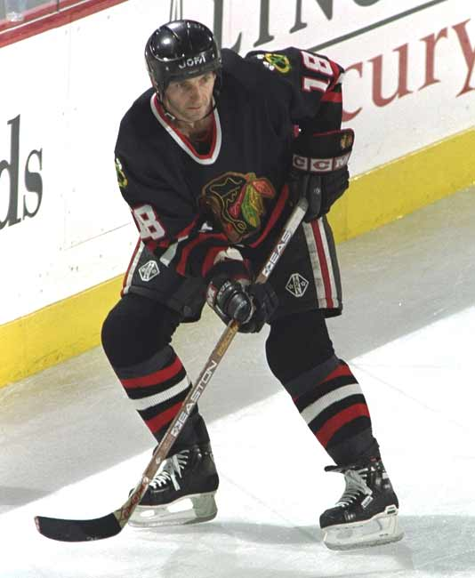 Chicago's Denis Savard scores his 1,000th career point.