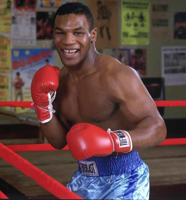 Mike Tyson KOs Tony Tubbs in the second round to retain the undisputed world heavyweight title.