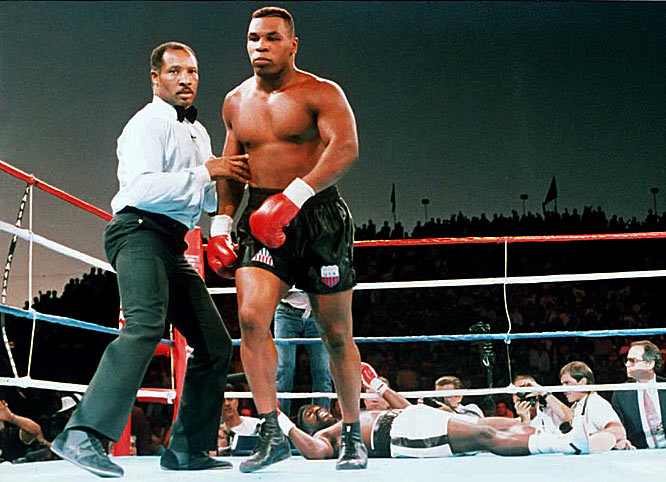 """Henry Tillman had defeated Tyson twice during the former champ's amateur career. But Iron Mike got revenge just four months after losing his titles to Douglas. The """"Baddest Man on the Planet"""" KO'd Tillman just 2:47 into their bout."""