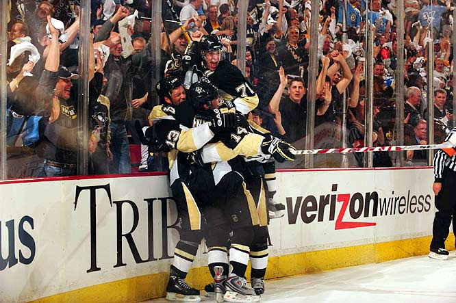 The Penguins' Evgeni Malkin (71) celebrates Bill Guerin's (13) game-winner against the Flyers 18:29 into overtime of Game 2 of their Eastern Conference quarterfinal.