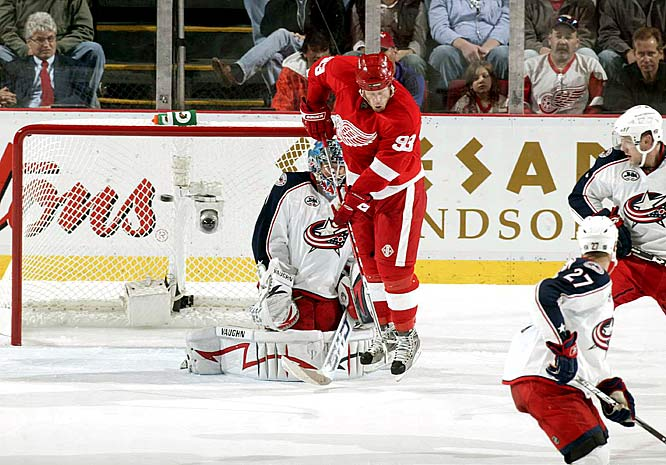 The Red Wings' Johan Franzen screens Blue Jackets netminder Steve Mason for a Niklas Kronwall goal (not pictured) during Game 1 of the Western Conference quarterfinals.