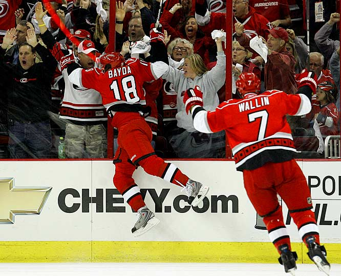 The Hurricanes' Ryan Bayda and Niclas Wallin celebrate Bayda's goal against the Devils during the first period of Game 3 of their Eastern Conference quarterfinal.