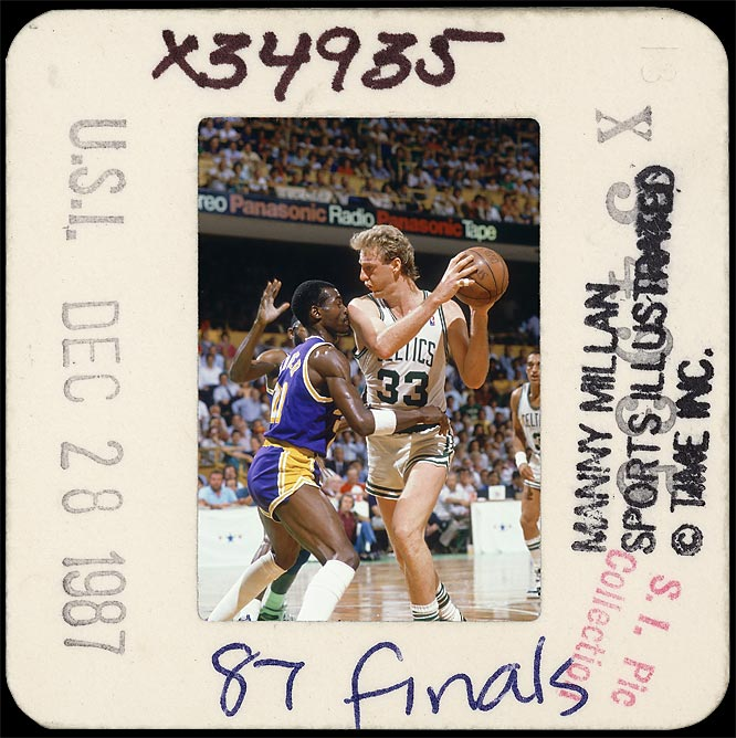 Clashing against Magic Johnson's team one more time, Boston Celtics star Larry Bird matches up against the Lakers' Michael Cooper in the 1987 NBA finals.