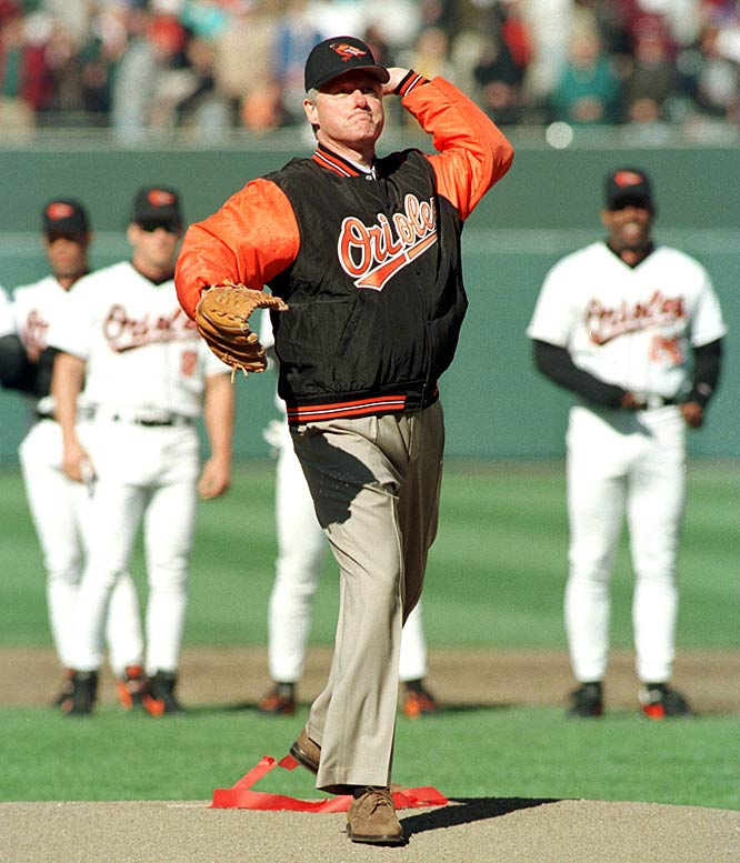 U.S. President Bill Clinton throws out the first ball preceding a game between the Kansas City Royals and the Baltimore Orioles.