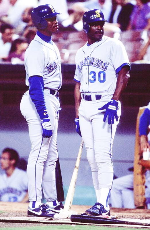 Ken Griffey, Jr. (pictured here with his father), the youngest player in the majors, hits his first career homer on the first pitch he ever sees at his home ballpark, the Kingdome.