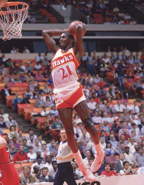Atlanta's Dominique Wilkins becomes the 11th player in NBA history to score 22,000 career points after hitting 41 in the Hawks' 110-107 setback against Charlotte.