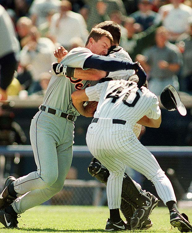 After being hit by a pitch thrown by White Sox starter Jim Parque, Dean Palmer charges the mound beginning a series of brawls which would continue to erupt throughout the game.  By the time the White Sox emerge victorious, 11 participants were ejected from the game.  In the days after, 16 players and coaches were suspended -- the largest suspension in MLB history.