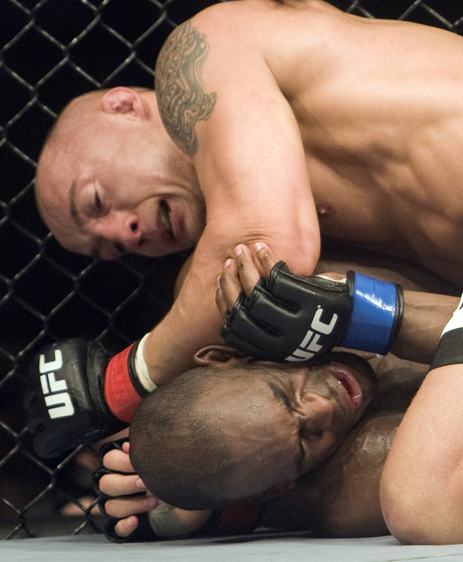 "In his second UFC fight, middleweight Kang (top) put an end to Foupa-Pokam's seven-fight win streak. Kang defeated ""Prof X"" by unanimous decision."