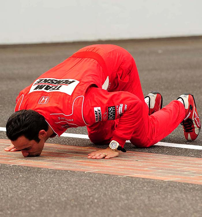 Castroneves pays homage to the Brickyard track after his win. He became the ninth driver to win the historic race three times.