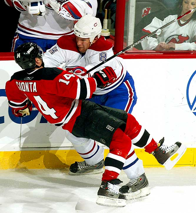 At 6'4'' and 240 pounds, Komisarek adds snarling menace to Montreal's backline and is happy to get as good as he gives. He ranked fourth in the NHL in blocked shots (207) this season. To many observers, he's a throwback. ''[In 1982, when] Scott Stevens came along, there were other players in the league like him who played hard and gritty and nasty,'' L.A. Kings coach Terry Murray told Sports Illustrated. ''Now, you see, who? Phaneuf and Komisarek.''<br><br>Send comments to siwriters@simail.com