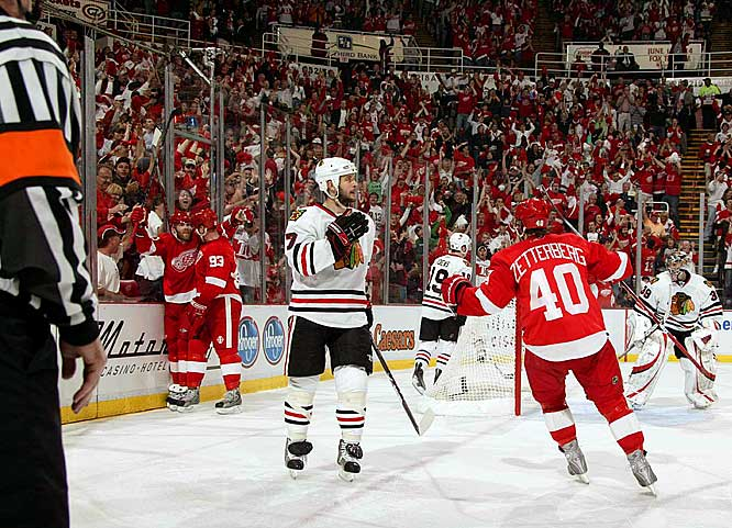Dan Cleary (left) celebrates his second goal of the game with teammate Johan Franzen during the third period of Game 1 of the Western Conference Finals.  Cleary's two goals helped lead the Red Wings to a 5-2 win over Chicago in the opening game of their series.