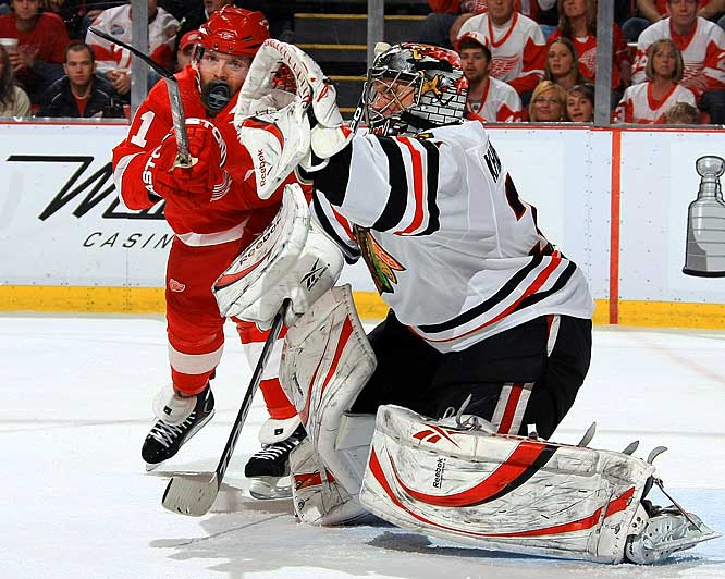 Dan Cleary tries to tip the puck as Blackhawks netminder Nikolai Khabibulin gets a glove on it during Game 1 of the Western Conference Finals in Detroit on May 17.