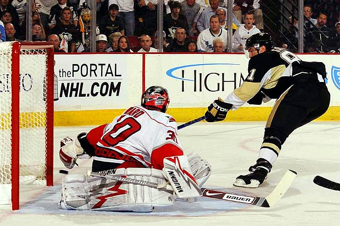 Miroslav Satan shoots and scores against Hurricanes goalie Cam Ward during the third period of Game 1 the Eastern Conference Finals.  Satan's goal was his first of the playoffs, and the first scored in the Pittsburgh/Carolina series. The Penguins won 3-2.
