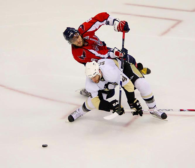 Ovechkin (8) and Penguins defenseman Rob Scuderi (4) get tangled up while going after the puck in Game 5.  Ovechkin scored two goals in the Caps' overtime loss.