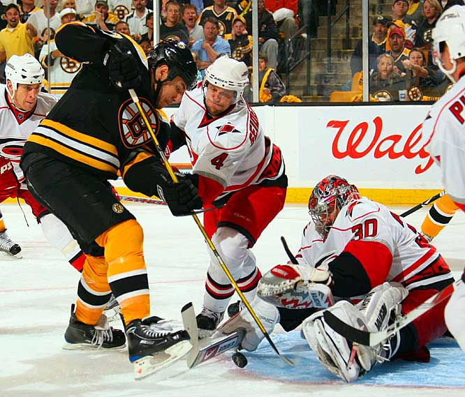 Hurricanes goalie Cam Ward stops the Bruins' Milan Lucic in Game 1.  Boston defeated Carolina 4-1 in the opening game of their series.