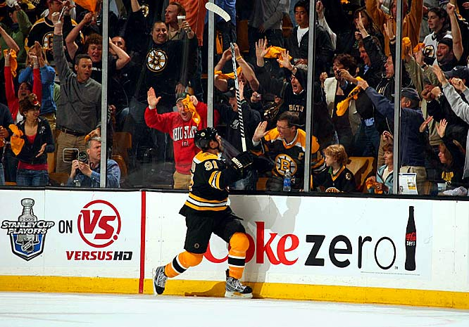 Bruins center Marc Savard celebrates his first of two goals against the Hurricanes during Boston's 4-1 victory in Game 1.