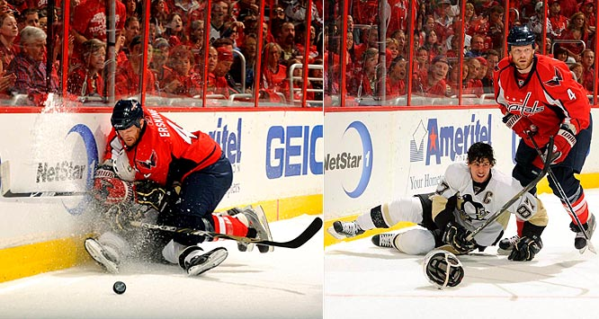 Capitals defenseman John Erskine checks Sidney Crosby into the boards during the first period of Game 1.  Washington defeated Pittsburgh 3-2 in the opening game of their series.