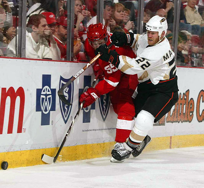 Ducks center Todd Marchant (22) checks Detroit Red Wings defenseman Niklas Kronwall (55) into the boards during Game 2 of their 2nd round playoff series.
