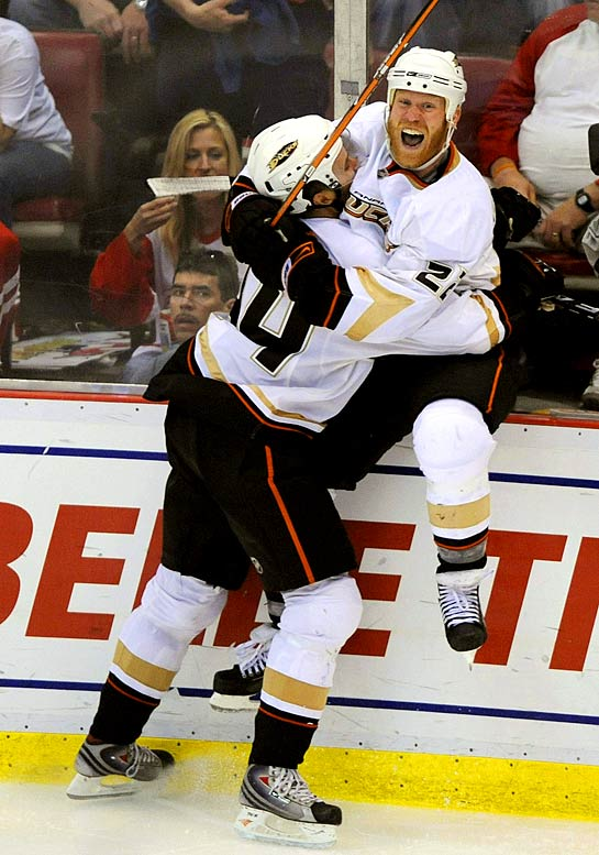 Ducks forward Todd Marchant celebrates his game-winning goal in the third overtime with teammate Rob Niedermayer to beat the Red Wings 4-3 in Game 2.