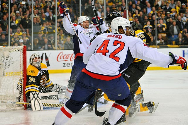 It was fitting that perhaps the closest playoff series in NHL history -- all seven games were decided by one goal -- ended in overtime. Matt Hendricks and Joel Ward, two forwards who combined for all of 10 goals in 151 regular-season games, were all the offense Washington needed as rookie goalie Braden Holtby came through in a thrilling 2-1 win at TD Garden that ended Boston's defense of the Stanley Cup. The winning goal came after Mike Knuble blocked Benoit Pouliot's dump-in to Washington's zone. Knuble raced down the ice, shot, and bumped into goaltender Tim Thomas as the rebound came out to Ward, who backhanded the puck into the net. It was a remarkable outcome given that few people thought the Capitals had much of a chance after their up-and-down season that saw coach Bruce Boudreau replaced by Dale Hunter in November.