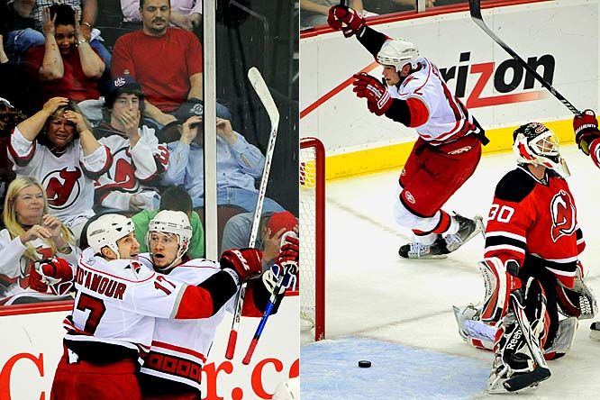 "Up 3-2 on home ice with the great Martin Brodeur in net and less than two minutes left to play, the Devils were sitting pretty, or so it seemed. Then Jussi Jokinen (left) scored for the Hurricanes with 1:20 to go and Eric Staal (right) shocked New Jersey by beating Brodeur with 32 ticks to spare on the clock. ""This is as sweet as it comes,"" said Carolina goaltender Cam Ward, who made 32 saves. ""That's why you never give up and play until the final buzzer."""