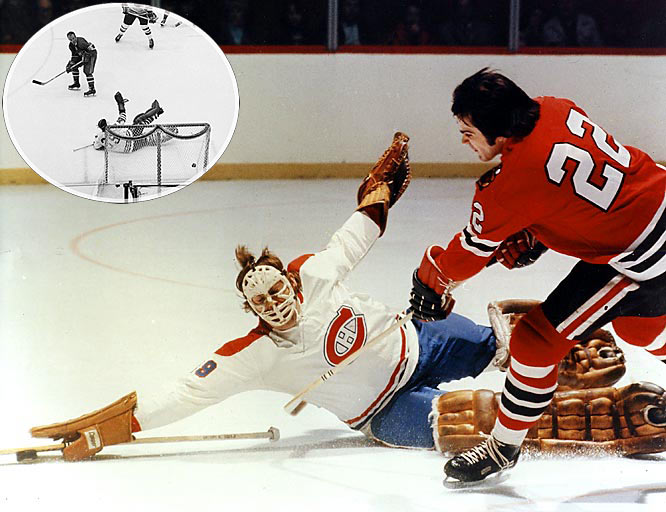 Montreal's rookie goalie Ken Dryden began cementing his legend by holding off the Blackhawks in Chicago long enough for his team to rally from a 2-0 hole late in the second period. Henri Richard scored the tying and decisive goals against Chicago's Hall of Fame netminder Tony Esposito (inset).